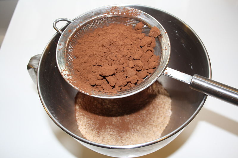 Sieve the coco powder and flour and add to the bowl with sugar.